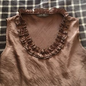 Tan sleeveless blouse with ruffled neckline